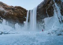 Watch When Frozen Waterfall Collapses While Ice Climber Climbs It! 2