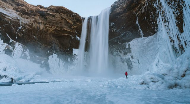 Watch When Frozen Waterfall Collapses While Ice Climber Climbs It! 14